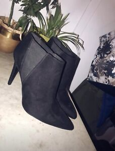 Black high heel ankle high boots