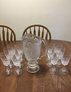 Set of 12 wine glasses and glass pitcher