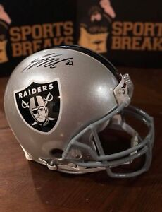 Signed Full sized football helmets