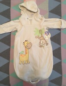 Brand new baby snowsuit and bunting 9mths