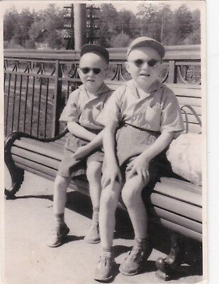 1950s Cute little boys brothers on the bench fashion old Russian Soviet photo