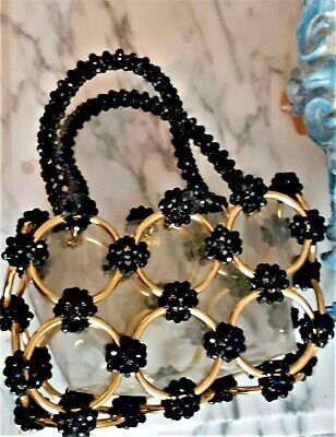 1950s Handbags, Purses, and Evening Bag Styles Vintage handbag, unique black beaded and gold links 1950s/60s made in Italy $45.00 AT vintagedancer.com