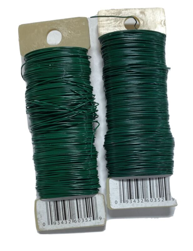 TWO REMNANT ROLLS OF 24 GAUGE GREEN FLORAL PADDLES WIRE - APPROX 300 Ft