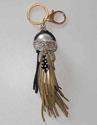S059 - Taschenanhänger - NEU - Gold Schwarz Puppe Quaste Sonnenbrille Perle Girl