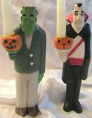 PAIR OF HALLOWEEN CANDLESTICKS: CARVED FRANKENSTEIN MONSTER & COUNT DRACULA