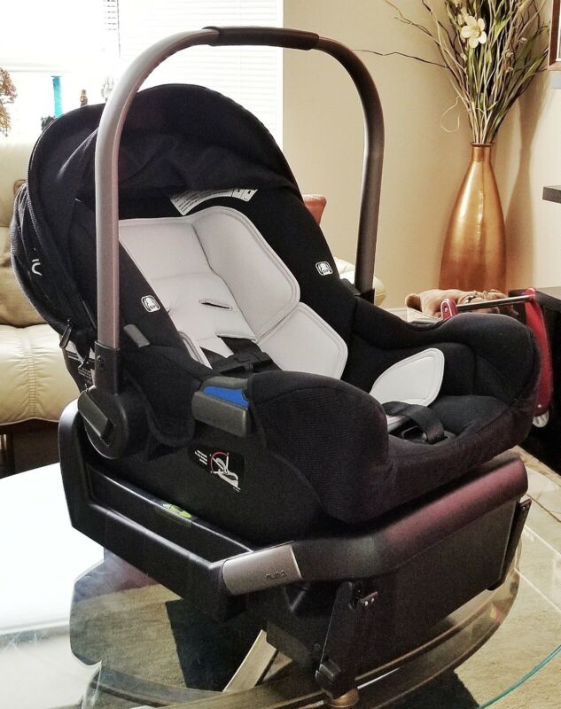 Nuna PIPA Infant Car Seat - Black w/ Base Infant Insert and Store Away Canopy