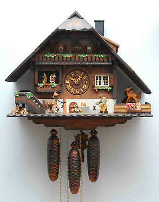 HUGE VINTAGE ANIMATED CUCKOO CLOCK BLACK FOREST GERMANY BLACKSMITH CHALET 8 DAY  Black Forest Chalet Cuckoo Clock