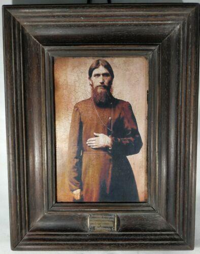 Portrait of Grigory Rasputin in wooden frame.