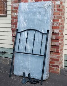Single bed with wrought iron bed head, on castors Highett Bayside Area Preview