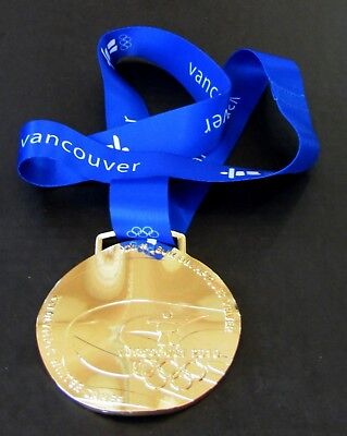 Vancouver 2010 Olympics (2010 VANCOUVER WINTER OLYMPICS GOLD MEDAL WITH SILK RIBBON & STORAGE POUCH )