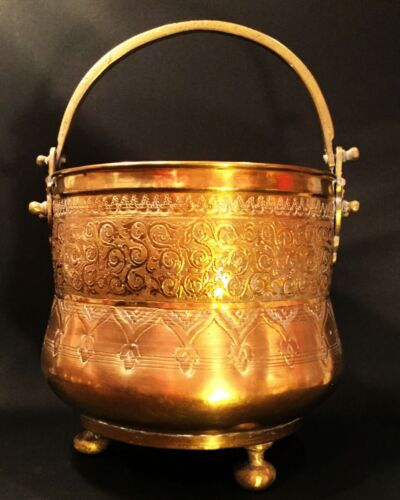 Chinese brass cauldron. Footed large pot with handle. Engraved Asian motif. .