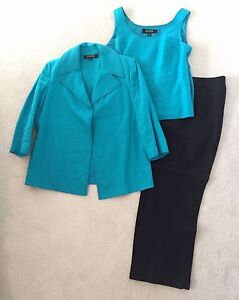 Blue blazer and top with black pants