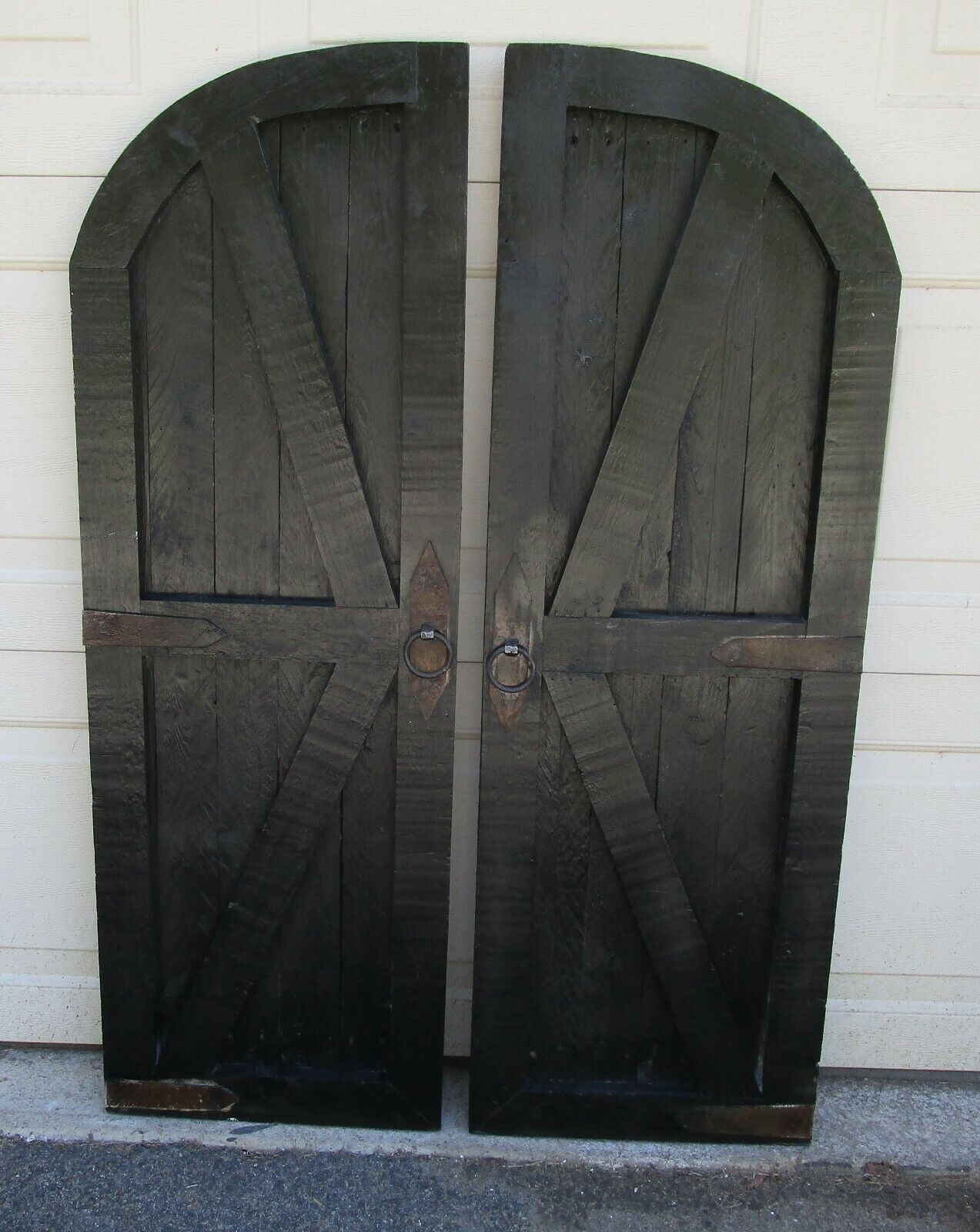 Pair of vintage inspired round top barn doors with hardware wall decor