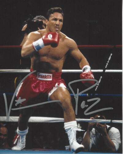 World Champion Vinny Pazienza autographed 8x10 color photo charging in ring