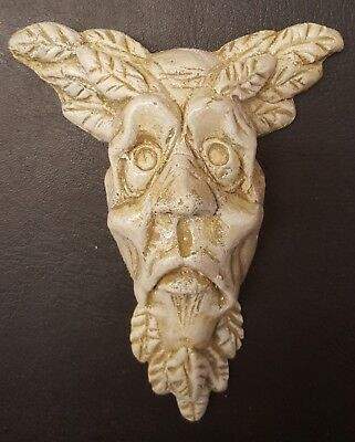 Green man wall plaque leaf face sandstone color gothic man face
