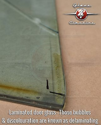 The bubbles and discolouration you can see are known as de-lamination. Something that is unavoidable on laminated glass.