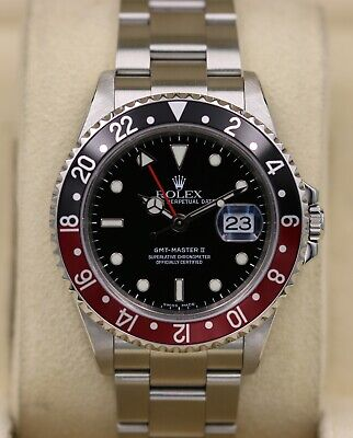 Rolex GMT Master II 16710 Coke - D Serial No Holes Case - Box & Papers
