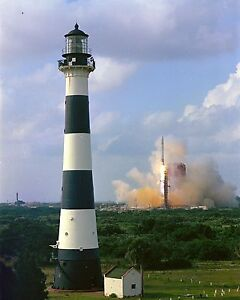 Atlas-Centaur rocket launches behind Cape Canaveral lighthouse Photo Print