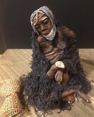 Original ethnic art sculpture by artist Karen Terry 12 in x 10 in base