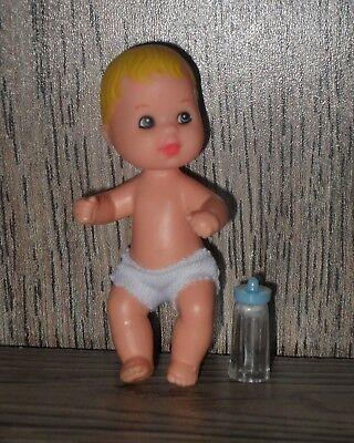 Muñeco Bebe de muñeca Barbie Fashionista con biberon b