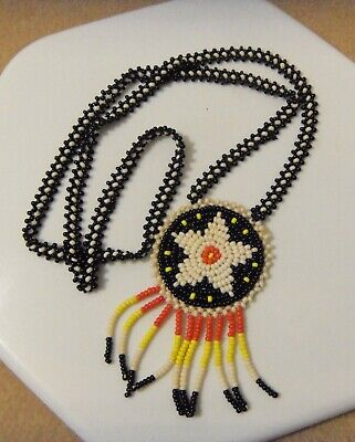60s -70s Jewelry – Necklaces, Earrings, Rings, Bracelets Vtg 1960's Native American STYLE Seed Beaded Medallion Necklace w/Star & Fringe $24.95 AT vintagedancer.com