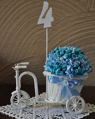 Wicker bicycle on the wedding table from Rustic Art - a great idea for numbering