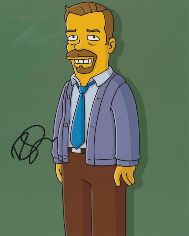 RICKY GERVAIS SIGNED THE SIMPSONS 8X10 PHOTO