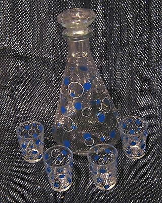 Very pretty small decanter and 4x small glasses like shot glasses