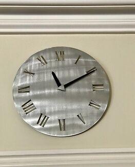 Brushed aluminium clock