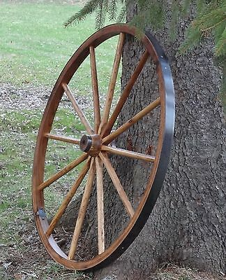 "VERY RUSTIC 36"" LARGE WAGON WHEELS. QUALITY HARDWOOD. 2"" WIDE RIM. IMPRESSIVE."