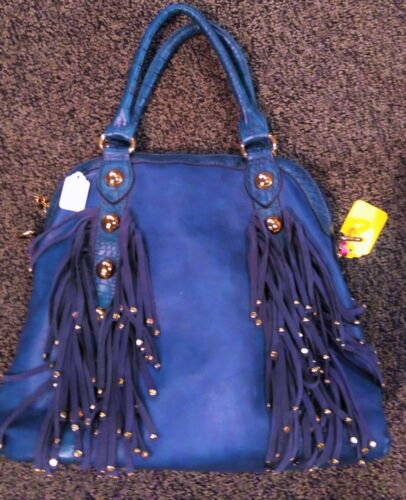 Beautiful design and color handbag!! Makes a statement and lots of room