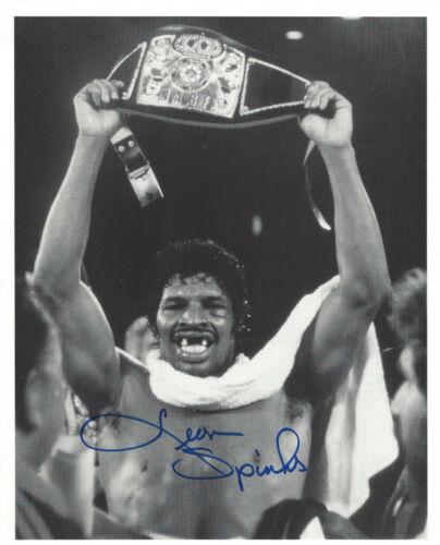 Leon Spinks autographed 8x10 b/w photo Holding Championship Belt