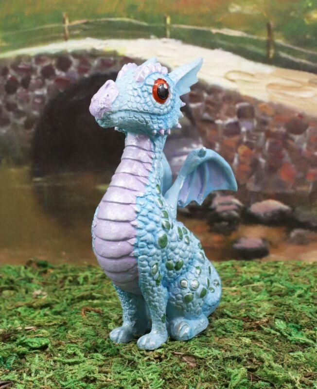 Sitting Whimsical Blue Wyrmling Baby Dragon with Green Polkadot Spots Figurine