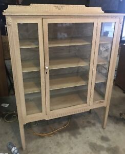 Antique wood and glass cabinet showcase display
