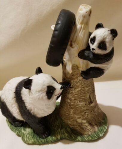 Porcelain Pandas on Tree Statue