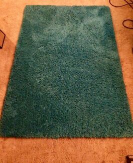 Aqua blue shag pile rug