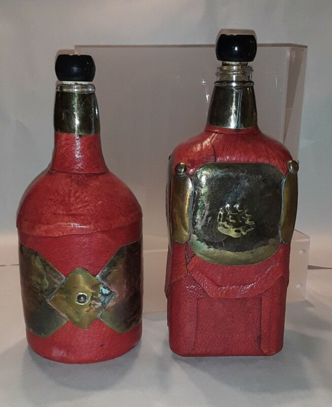 decorative bottles wrapped in faux red leather and metal black stoppers (2)