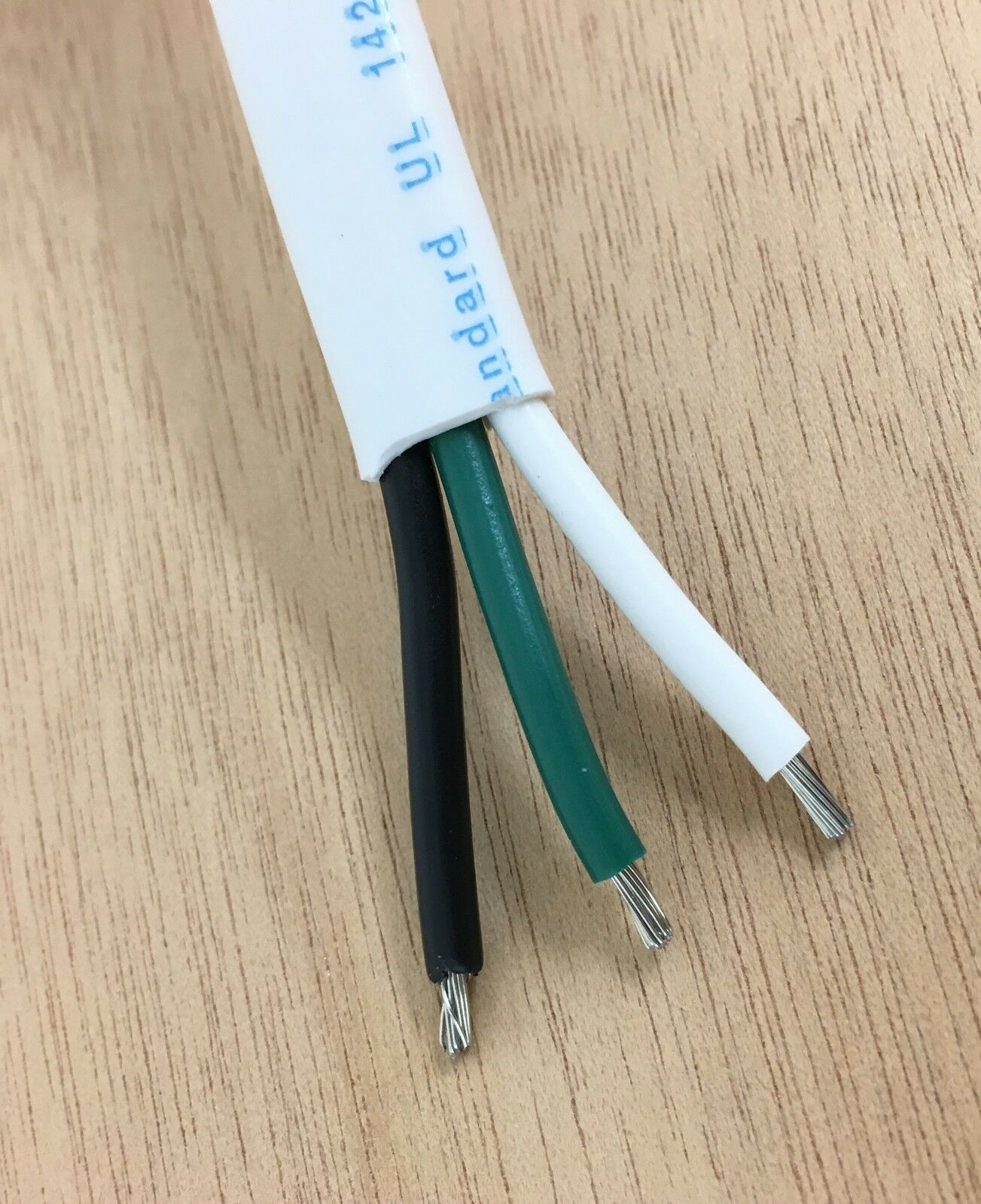 14 AWG 3 Conductor Wire, Marine Grade Boat Cable with White overall jacket  with Black, White and Green conductors inside used for wiring AC  applications.