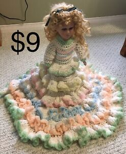 Porcelain doll with knitted dress