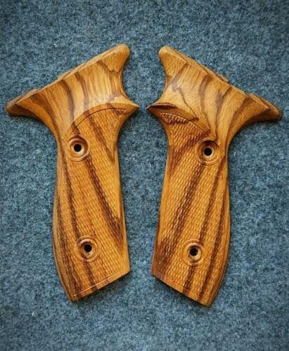 Margolin pistol, the grips of wood zebrano