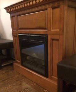Electric fireplace with space heater