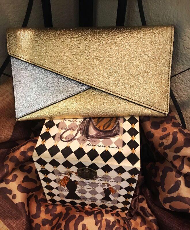 Clutch 1990's? Retro Angle cut flap closure, gold & silver, Estée Lauder