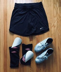 Soccer shoes, shorts, and shin pads