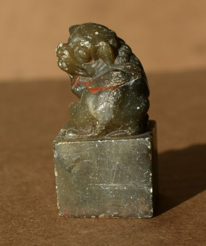 An Old Oriental Chicken Blood Stone Seal with Foo Dog Head