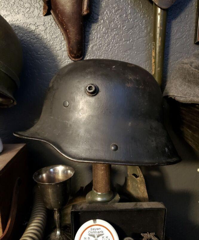 Original WW1 German to WW2 Transitional helmet. Named Finnish corporal.