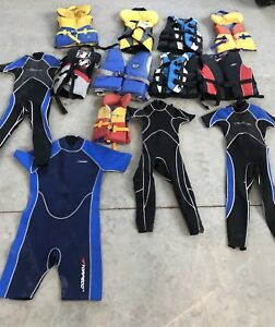Assorted life jackets and wetsuits $10 each