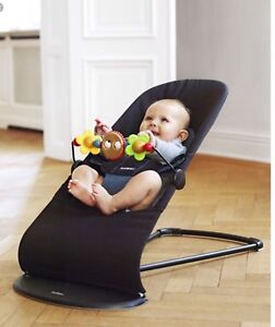 Baby Bjorn Balance Bouncer Chair and wooden toy
