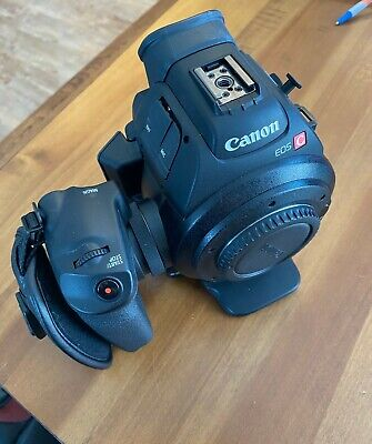 Canon EOS C100- Body, Top Handle, and Two Batteries (and cords) Included