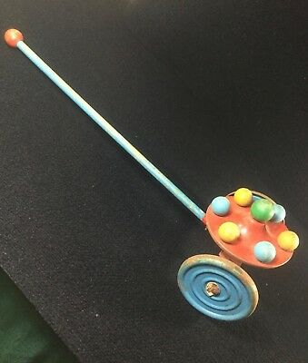 VINTAGE THE GONG BELL MFG. CO. SPINNING TOP PUSH PULL TOY WOOD METAL. BELL WHEEL