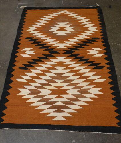 """Navajo Rug Weaving: Dark Brown, Serrated Cloud & Lightning Motif, 40x63"""" 1950"""